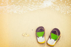 Retro slippers on tropical beach in summer Stock Images