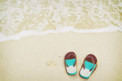 Retro slippers on tropical beach in summer Royalty Free Stock Images