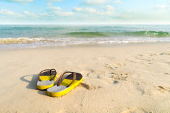 Retro slippers on tropical beach in summer Royalty Free Stock Photos