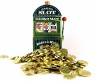 Retro slot machine with 77bar. And lots of gold for winnings stock images