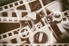 Retro SLR camera on background of perforation film. Retro SLR camera on the background of the perforation of film Stock Photo