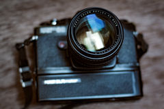 Retro slr camera with grip and fast 50mm lens Stock Photos