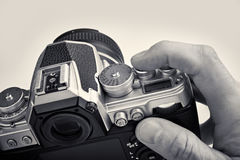 Retro SLR camera in hands of photographer closeup Royalty Free Stock Image