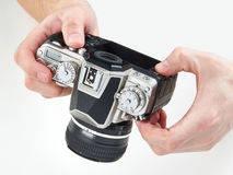 Retro SLR camera in hands of photographer isolated Stock Photo