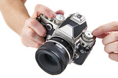 Retro SLR camera in hands of photographer isolated Royalty Free Stock Images
