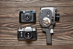Retro SLR camera, rangefinder and mechanical movie camera Royalty Free Stock Photo