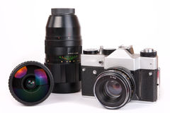 Retro SLR camera with set of lenses Stock Photography