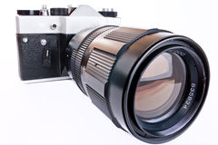Retro SLR camera with telephoto lens Royalty Free Stock Photos