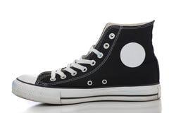Retro sneaker on a white background. One black retro high top sneaker on a white background royalty free stock photos