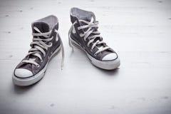 Retro sneakers. Pair of Retro Sneakers on the floor Stock Photography