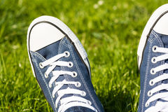 Retro Sneakers On Green Grass Royalty Free Stock Photography
