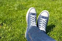 Retro Sneakers On Green Grass. Background stock photography