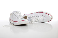 Retro sneakers on a white background. A pair of white retro sneakers on a white background royalty free stock image