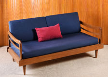 Retro Sofa with Navy Blue Cushions in Living Room Royalty Free Stock Photography