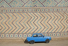Retro soviet car near Bibi-Khanym mosque wall Royalty Free Stock Images