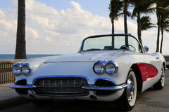 Retro Sports Car At the Beach. White and red sports car parked on the street along a South Florida beach Stock Photography