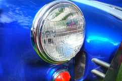 Retro Sports Car Headlight. Close-up photo of a headlight for a 1960s sports car Royalty Free Stock Photography