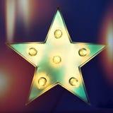 Retro star with light bulbs. Vintage design Stock Photography