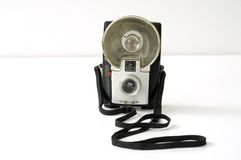 Retro starflash kodak camera. Symmetrical Retro art deco style starflash kodak brownie with unflashed flash bulb and cord brown bakelite body on white background stock image