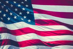 Retro Stars And Stripes Flag. Retro Filtered Image Of A American Stars And Stripes Flag Flying In The Breeze Stock Photos
