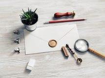 Retro stationery, envelope. Blank envelope and retro stationery light wood table background. Responsive design mockup stock photography