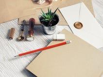 Retro stationery set. Blank retro stationery set on light wood table background. Mockup for your design stock image