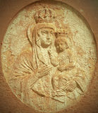 Retro statue of the Virgin Mary with the baby Jesus Christ in he Royalty Free Stock Image