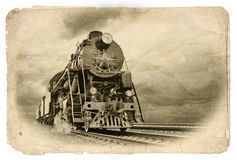 Retro steam train in motion royalty free stock image