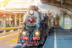 Retro steam train stands on the vintage railway station. Retro steam train stands on the vintage railway station royalty free stock images