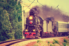 Retro steam train at summer day time. Stock Photo