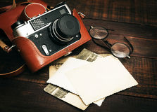 Free Retro Still Camera And Some Old Photos On Wooden Table Background Royalty Free Stock Photos - 57165408