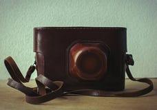 Retro still camera in case Stock Photo
