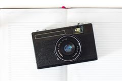 Retro still camera and some old photos on white background . Retro still camera and some old photos on white background Stock Photography