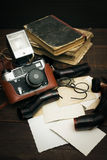 Retro still camera and some old photos. On wooden table background royalty free stock photos