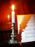 Retro still life. With sheet music and piano at candle light royalty free stock photos