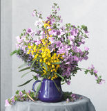 Retro still life with bouquet  of violet and yellow flowers in the blue vase Royalty Free Stock Image