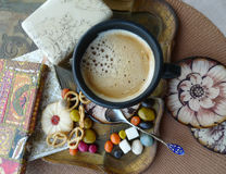 Retro still life. A cup of coffee with cream, cookies and candy on a tray. Royalty Free Stock Photos
