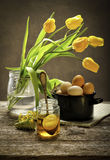 Retro still life with eggs and tulip Royalty Free Stock Photography