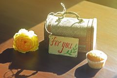Retro still life: flower, casket with label `for you`. And sweet cake. Photo with vintage color toning. Concept of gift greeting, surprise royalty free stock photos