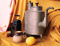 Retro still life. With kettle and lamp Stock Images