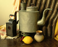 Retro still life. With kettle and lamp Stock Image