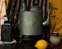 Retro still life. With kettle and lamp Royalty Free Stock Images