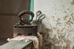 Retro still life with old rusty iron and textile Stock Image