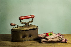 Retro still life with old rusty iron on wooden Royalty Free Stock Photography