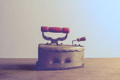 Retro still life with old rusty iron on wooden Stock Photography