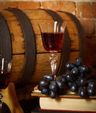 Retro still life with red wine and barrel. Retro still life with red wine, books and barrel royalty free stock photos