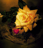 Retro still life - tea-rose and symbol of heart Royalty Free Stock Photography