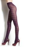 Retro stockings on long sexy legs isolated on white Stock Photo