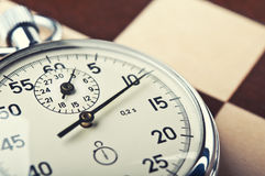 Retro stopwatch. Stopwatch and chessboard on a background Stock Photo