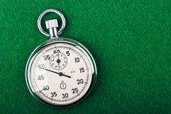 Retro stopwatch. On a green background Royalty Free Stock Image